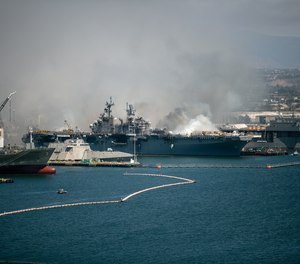 Emergency crews responded to the scene of a fire aboard the USS Bonhomme Richard on Sunday, July 12, 2020 in San Diego, Calif. The ship will be decommissioned within a year and will be scrapped, a Navy official told reporters during a conference call Monday.