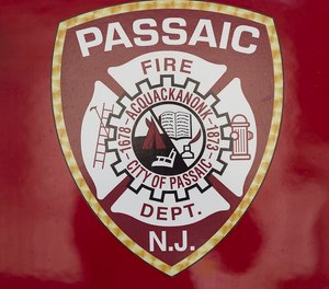 A firefighter was taken to the hospital after being struck by debris while battling a four-alarm blaze in Passaic County on Thursday. Several other firefighters sustained minor injuries and were treated at the scene.