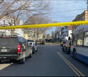 This is the scene of a shooting on Enfield Street Wednesday morning. The Courant has learned that an FBI agent was involved.