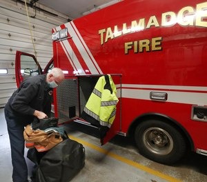 Tallmadge Firefighter-Medic David Lee loads his turnout gear into a med unit as he starts his shift. About 60% of Tallmadge Fire Department employees have gotten the first dose of the COVID-19 vaccine. In all of Summit County, only about 40% of EMS providers have opted in to receive the first dose.