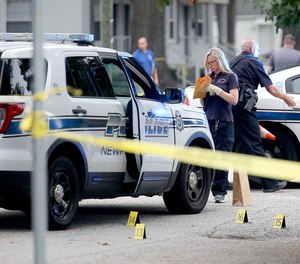Newport News police investigate a scene at the Cottage Grove Apartments in the aftermath of a shooting on Aug. 17, 2019.