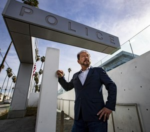 Chang Lee, 63, stands for portrait in front of the LAPD Olympic Station on Thursday, Jan. 7, 2021 in Los Angeles, CA.