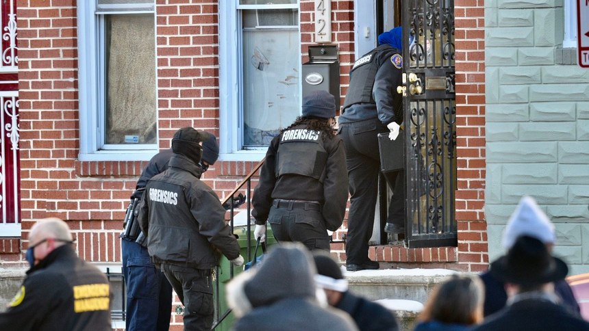 Authorities enter a home in West Baltimore where a U.S. Marshal was shot attempting to serve an arrest warrant.