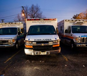 A judge has reinstated the licenses of two EMTs accused of striking a patient in the back of an ambulance in Jersey City, citing a