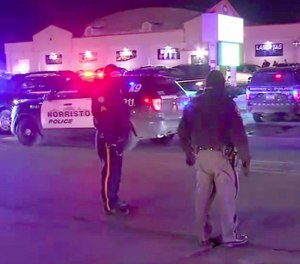Police in East Norriton, Pennsylvania, respond to a shooting at a bowling alley that left one dead and three others injured.