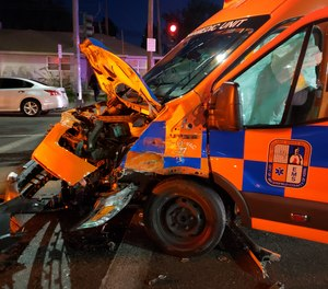 A Hall Ambulance Service crew is being lauded for their patient care actions after their rig was struck by another vehicle on Saturday.