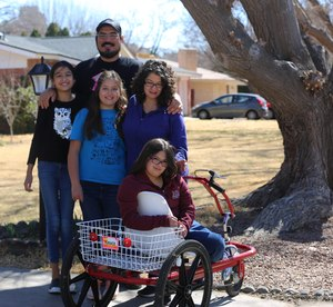 The Holguin family is pictured outside their home on Capri Arc in Mesilla on Friday, Feb. 21, 2021.