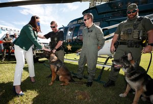 Florida Attorney General Ashley Moody (left, in foreground) joined dozens of K-9 officers Friday in showing support for a bill that would allow EMS providers to transport K-9s injured in the line of duty.