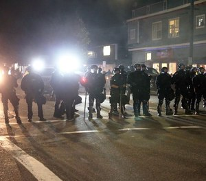 Portland Police declared a riot Tuesday, June 30, 2020, as protesters gathered outside Portland Police Union headquarters on North Lombard Street.