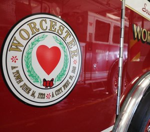 A man is accused of setting a car on fire and trying to stop Worcester firefighters from extinguishing the flames.