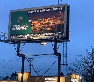 This April 4, 2021, photo shows one of a handful of billboards that was up in Portland advertising Spokane County Sheriff's Office's $15K hiring bonus for mid-career officers.