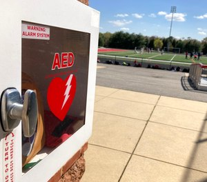 This photo shows a wall-mounted AED near an athletic field at Spalding High School in Severn, Maryland. Officials say a freshman lacrosse player who was struck in the chest by a ball was saved by an on-site AED at the Loyola Blakefield campus earlier this month.