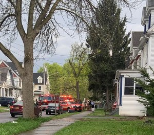 Syracuse firefighters rescued an unconscious woman from a house fire on Wednesday. Three firefighters were injured battling the blaze.