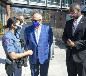 From left, Howard County Police Department s Asian community liaison officer Stella Dieu talks with Maryland Gov. Larry Hogan and County Executive Calvin Ball during a visit to Ellicott City on March 22.