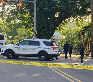 Birmingham police investigate a double homicide near the city s Brother Bryan Park on Southside. The suspect was later killed in a shooting with police that injured four officers.