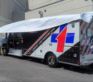 UF Health Jacksonville officials unveil one of two new TraumaOne ambulances outside the downtown emergency room.