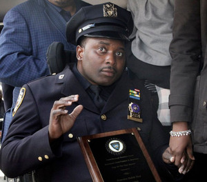 NYPD Detective Dalsh Veve receives the Chief Patrick D. Brennan Award at the 67th Precinct in Brooklyn on October 24, 2018.