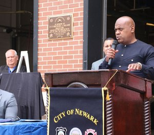 Newark Mayor Ras Baraka (right) speaks at a press conference about a new initiative that will send firefighters to life-threatening EMS calls.