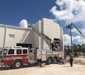Orange County Fire Rescueresponded about11 a.m. TuesdaytoConsulate DriveoffSouth John Young Parkway, where the two workers were trapped in the bucket touching electrical wires that are still charged