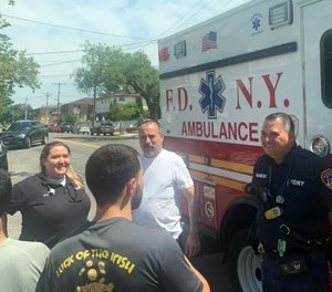 Queens dad Michael Lesner (in white T-shirt), who nearly died of a massive heart attack a week earlier, was reunited Saturday with the crew of EMS workers who saved his life.