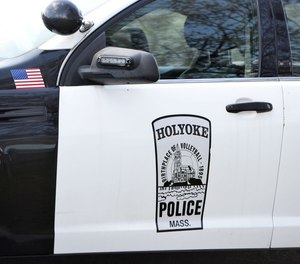 Police officers had to force their way into a Holyoke man's apartment after he allegedly stabbed a CHD social worker multiple times.