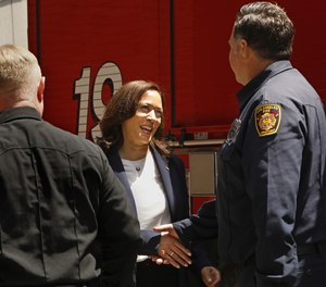 Vice President Kamala Harris shakes hands with fiefighter Eric Homsher at Los Angeles Fire Department Station 19, where she stopped to thank firefighters for their their service to their community during a stop in Los Angeles, California on July 4, 2021. (Carolyn Cole / Los Angeles Times)