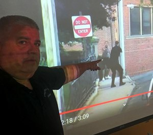 Springfield police firearms training officer Michael Dumas points to what he considers the most dangerous part of the June 20 pursuit. Both the suspect and officer are standing less than 50 feet apart, and each have their guns drawn. Dumas said if he were there, he would have opened fire in self defense.