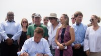 Conn. governor signs climate change law to protect shoreline, says he will push for more action in future