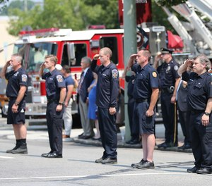 Hundreds of uniformed firefighters flanked the road where services were held for Sean DeMuynck, the volunteer firefighter who died in the line of duty the day before he was set to return home to Canada.
