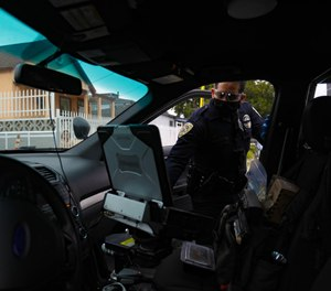 Officer Ruben Lopez with National City Police Department looks at the MDC in his vehicle during an investigation.