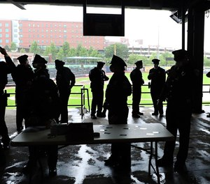 Cadets of the Akron Police Department Academy keep socially distanced as they await their graduation ceremony May 28, 2020, at Canal Park.