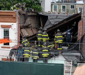"""""""A brick wall had collapsed onto workers on the second floor and brought the roof down on top of them, pinning them between the roof, the brick wall and the floor,"""" said FDNY Deputy Assistant ChiefJoseph Ferrante."""