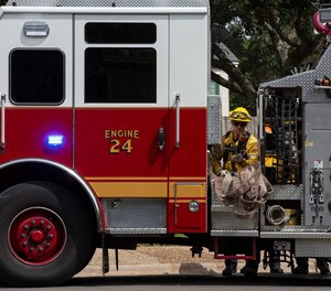 Firefighters practice tactics to manage and steer away fire as they participate in training Tuesday in West Austin.