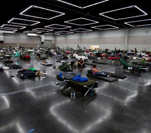 People made use of a cooling center at the Oregon Convention Center during Portland's unprecedented heat wave on Monday, June 28, 2021.