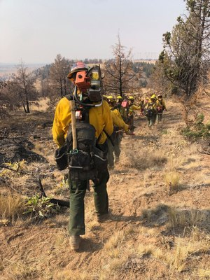 Florida Forest Service hand crew teams, in western states fighting wildfires, using shovels, hoes and other hand tools to cut fire line to protect homes and property.