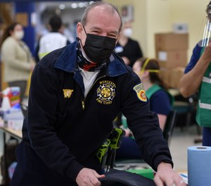 Fire Chief Michael J. Lavoie at a vaccination center.