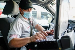 TransCare field operations supervisor Spencer Wynn monitors active ambulance calls and the state of local hospitals in Tampa.