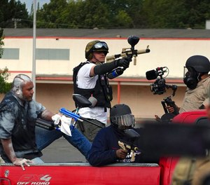 Members of the Proud Boys shoot paintballs at Antifa during a clash between left- and right-wing demonstrators in Northeast Portland on Sunday, Aug. 22, 2021.