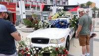 NASCAR fans pay tribute to slain Daytona Beach officer before race