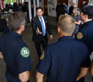 Sen. Marco Rubio talks with Jacksonville Fire and Rescue personnel before the start of a Tuesday presentation at Fire Rescue Station 50 on a bill to help first responders and teachers eliminate down payments and mortgage insurance requirements to buy their first homes.