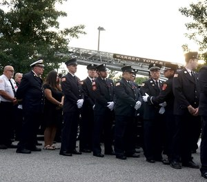 Firefighters from RI and neighboring Massachusetts march in procession to the the Smith Funeral &Memorial Service in Warren for Brian Remy, the Assistant Chief of the Warren Fire Department who was gunned down in Warren last week.