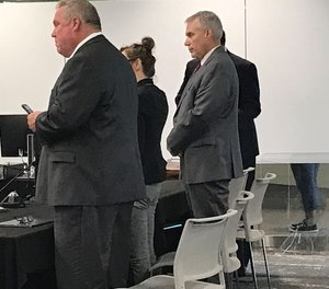 Former Cuyahoga County Jail Director Ken Mills, right, after a jury found him guilty of four misdemeanor counts in the trial where he was accused of mismanaging the county jail and lying to county council.