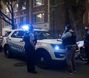 Chicago police officers work in the Rogers Park neighborhood of Chicago on Sept. 7.