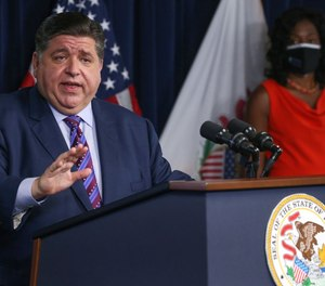 Under Gov. J.B. Pritzker's latest order, first doses must be received by Oct. 14; Friday's executive order marks the second time Pritzker has delayed a deadline for a vaccine mandate.