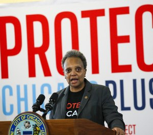 Mayor Lori Lightfoot answers questions at a COVID-19 vaccination site in Chicago on Feb. 19, 2021.