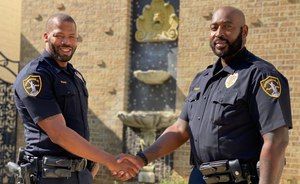 Birmingham police Officers Anthony Evans (left) and Michael Burnett recount their dramatic flood rescue of an unresponsive 87-year old woman.