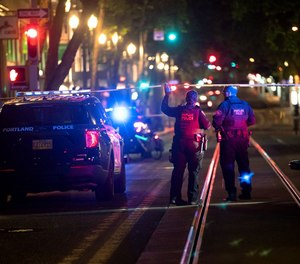 Police investigate a shooting early Saturday, July 24, 2021, in downtown Portland near Southwest Fifth Avenue and Washington Street.