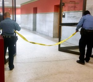 Police set up crime scene tape outside a Minneapolis police room at Minneapolis City Hall on Monday, Dec. 18, 2017.