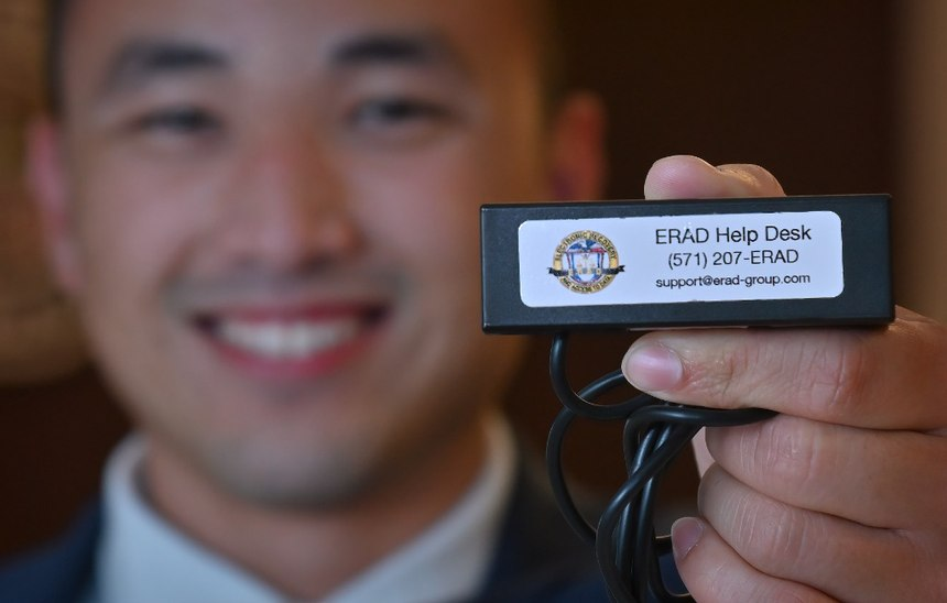 Westminster PD Fraud and Financial Crimes Detective Henry Tran shows the department'snew electronic tool that allows investigators check balances and freeze prepaid debit cards of potential criminal funds while still out in the field.