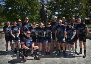 The Code 3 Cycling Team gathers in front of the Westminster Police Department's Officer's Memorial at the end of their 630 mile journey.